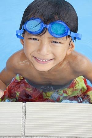 soak: Boy smile soak in the pool