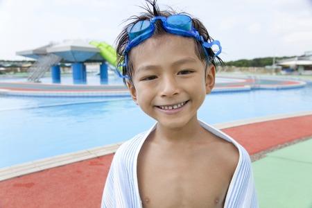 bath towel man: Boy swimsuit that winding a bath towel on the body Stock Photo
