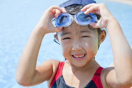a bathing place: Girls swimsuit with a goggles