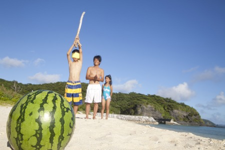 splitting: Parent and child to a watermelon splitting