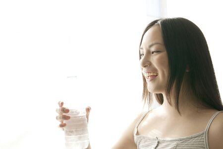 bottled water: Woman drinking bottled water