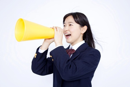 Middle school girls screaming with a megaphone