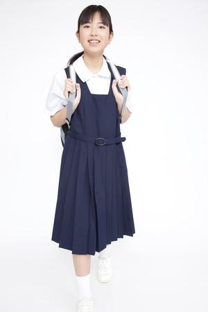 one people: junior high school girls walking Stock Photo