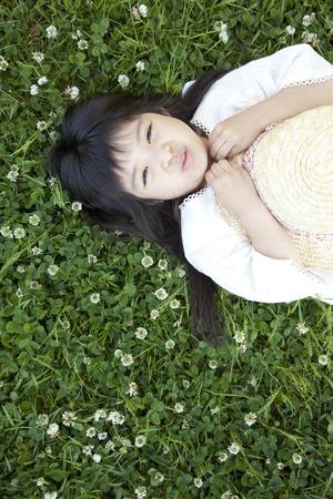 lie down: Girl lie down on grassland