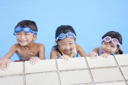 soak: Children smile soak in the pool