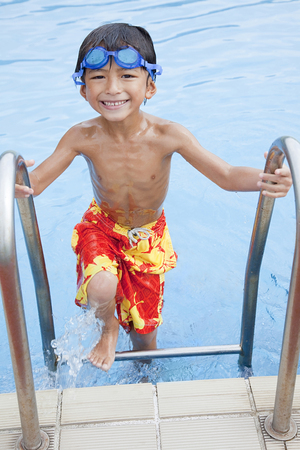 a bathing place: Boy swimsuit that rise from the pool