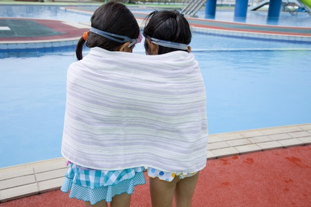 rear view girl: Rear View girl two of swimsuit that winding a bath towel on the body Stock Photo