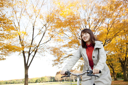happy asian people: Women ride bicycles