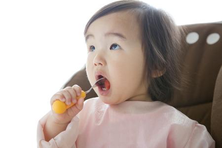 asian baby girl: Girl eating watermelon