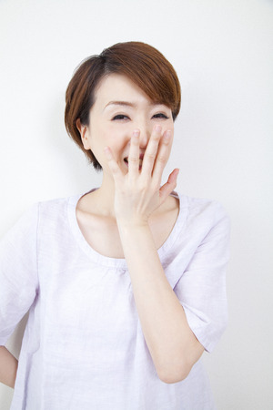 rely: Middle women laugh rely on hand-to-mouth Stock Photo