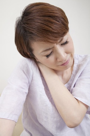 stiff: Middle woman suffering from a stiff neck Stock Photo