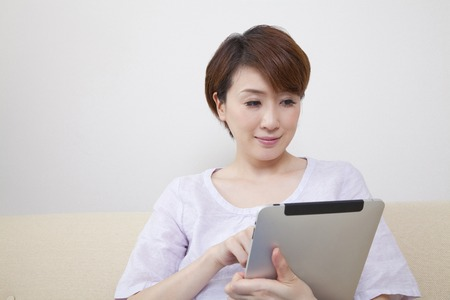 handheld computer: Middle Lady to work with Tablet PC Stock Photo