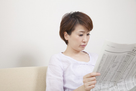 Middle women who read newspapers Stock Photo