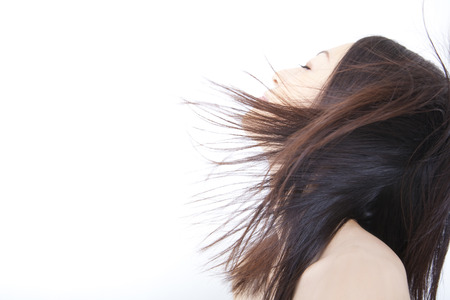 wavering: Women in the wind high above Stock Photo