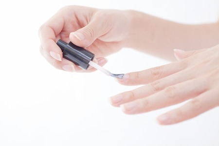 nailcare: Hand of a woman painting the nail Stock Photo