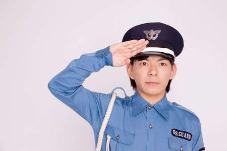 警備会社でアルバイト男性 写真素材