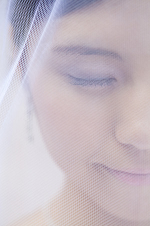 suffered: Bride of face-up suffered a veil Stock Photo