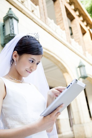 Bride to use the tablet PC Stock Photo