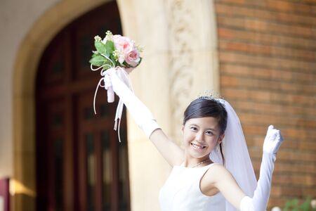 rejoice: Bride to rejoice by raising the hand Stock Photo