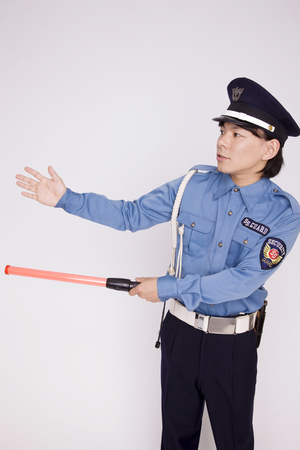 carry out: Men carry out the traffic security