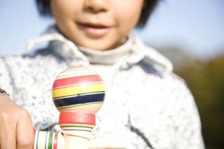 Elementary school students with a kendama