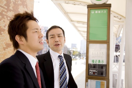 circumference: Two businessmen waiting for the bus Stock Photo