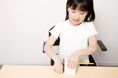 sharpen: Children sharpen a pencil