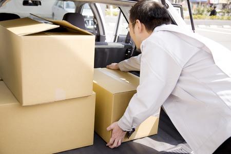 deliverables: Businessmen out of carrier bags