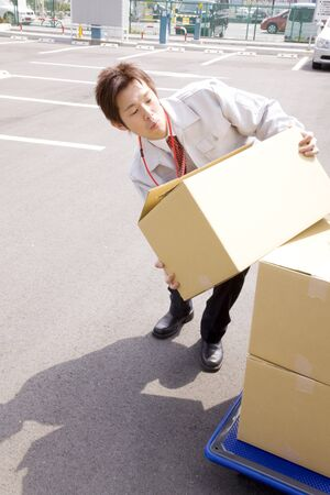 deliverables: Businessman re loading the luggage Stock Photo