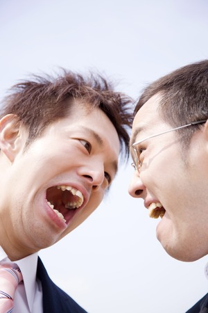 disparity: Businessman to colleagues and fight Stock Photo