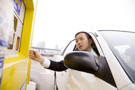 Businessman to put a parking ticket
