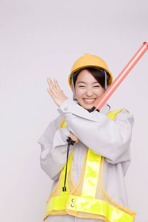 traffic cop: Female workers to a traffic cop Stock Photo