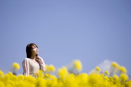 adult rape: Women enjoy in the flower garden Stock Photo