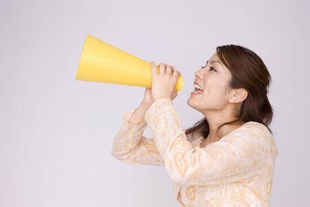 Women who cheer with megaphone 版權商用圖片