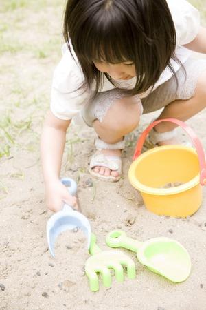 sandpit: Girl to the sandpit Stock Photo