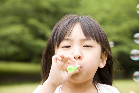 kindergartener: Girl playing with bubbles