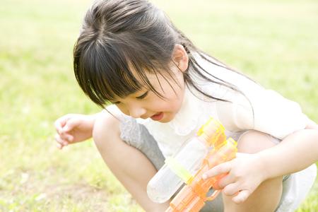 water gun: Girl playing with water gun