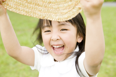 frolic: Girl playing in the straw hat