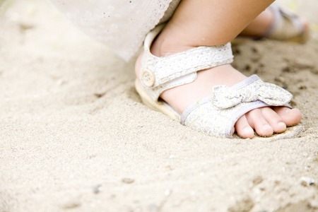 sandpit: Feet of girls to the sandpit Stock Photo