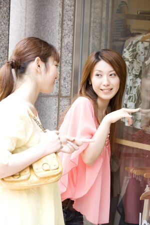 shopping buddies: Two women have been window shopping Stock Photo