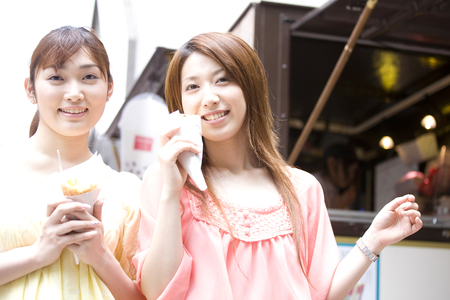 shopping buddies: 2 females who bought crepe
