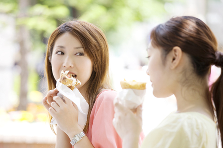 shopping buddies: 2 women of eating a crepe