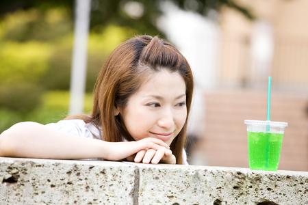 Women stare carbonated water 写真素材