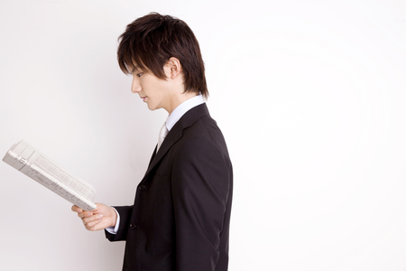 newcomer: Businessman reading newspaper