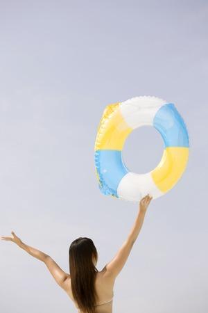 inner tube: Woman Holding the inner tube