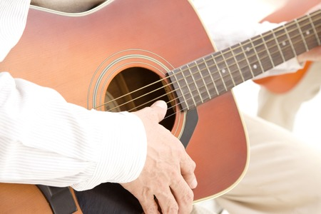 musical instrument parts: Hand of man playing the guitar