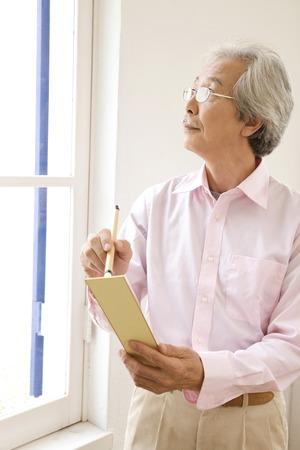 haiku: Old man to think of haiku Stock Photo