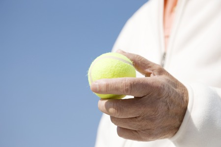 70s tennis: Hand with a tennis ball