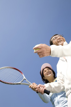 70s tennis: Couples who have a tennis Stock Photo