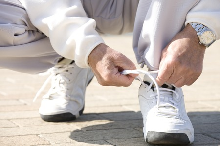 Hand of the man that connects the shoe laces